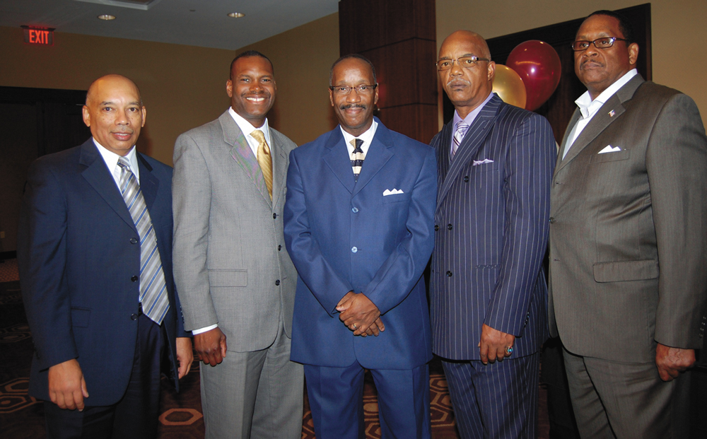 GREAT WORK—Awardees Gilbert Cannon, Richard Taylor, Esq., Edward Greene and Richard Portis standing in for Kenneth Elliot stand with Dr. Mitchel Nickols, center, after his keynote address. (Photos by Diane I. Daniels)